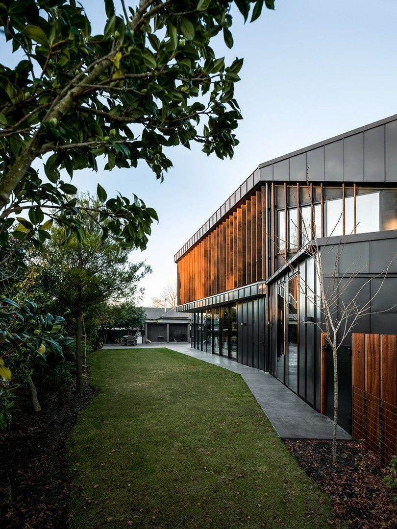 first light studio wraps the shark house in angular steel planes   timber in new zealand