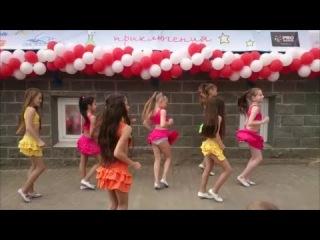 young girl dancing latino