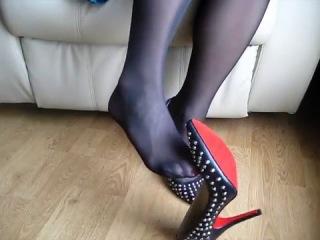 Shoe play, high heels, black nylon, hosed feet, dangling