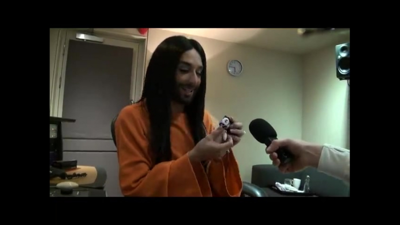 Conchita receives mini-Conchita, Mearns FM
