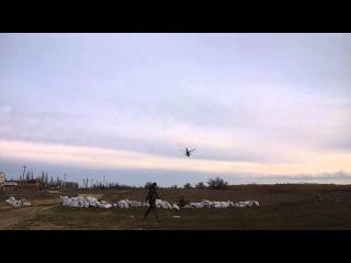 Российские вертолеты проходят над позициями украинских войск.