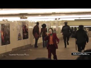 Joker movie filming new scene in brooklyn subway station - joaquin phoenix in full make up