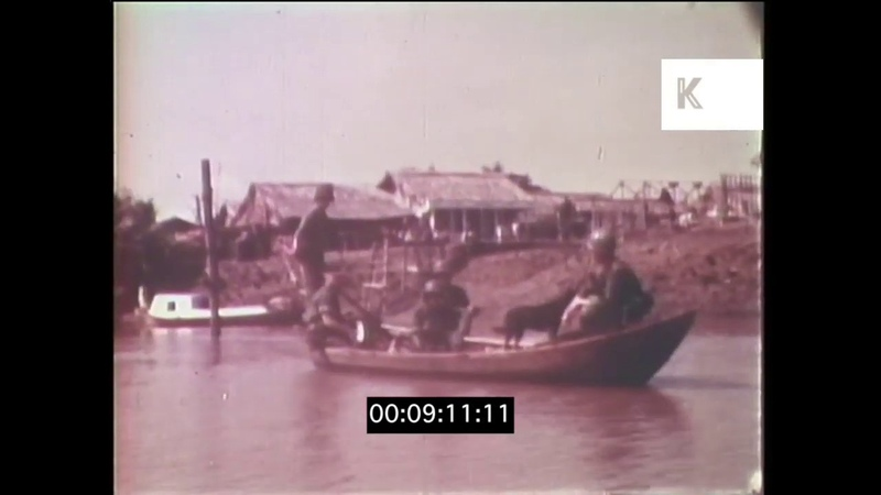 1960s 1970s Vietnam War US Marines and ARVN Troops in Canoes on River