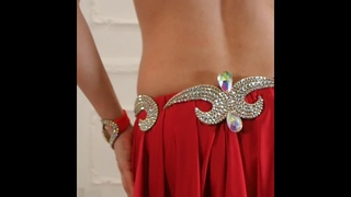 Belly dance fashion by Aida. Lady in red