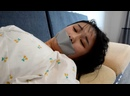 Shen Xin was in the room tied with gray tape to seal her mouth