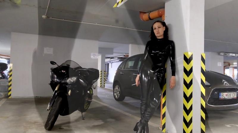 Latex catsuit and motorbike